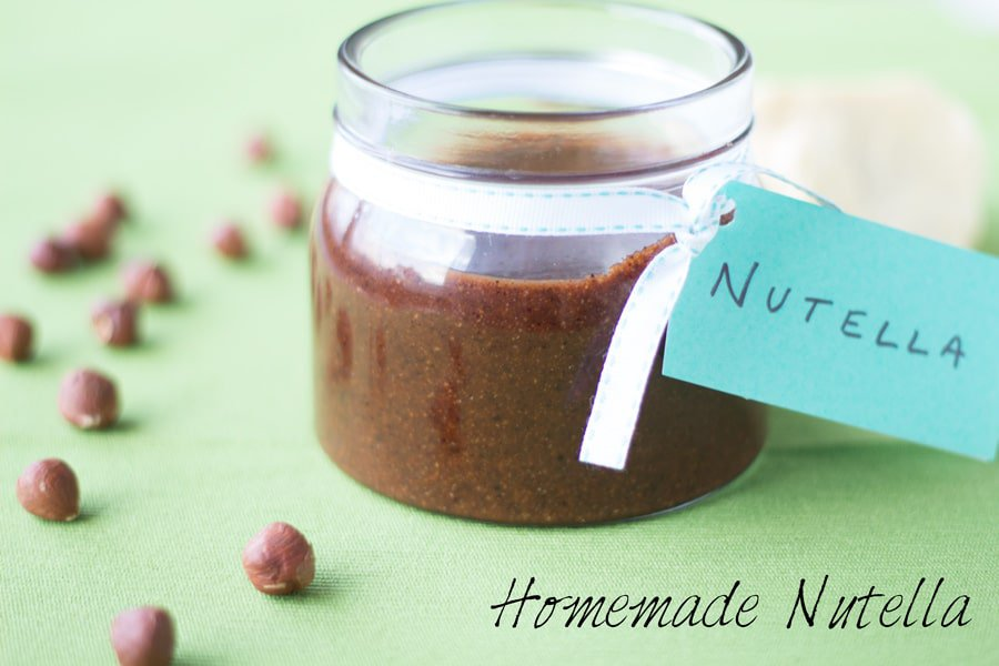 Jar of Homemade Nutella with a tag on a green table.