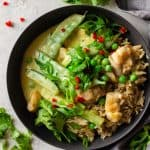 Chicken Thai Green Curry served over brown rice in a grey bowl.
