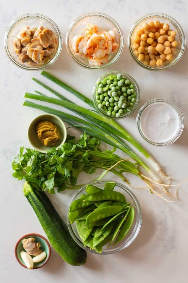 All ingredients for Thai Green Curry laid out on a kitchen counter.