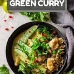 Thai Green Curry served over brown rice in a grey bowl with text overlay for Pinterest.
