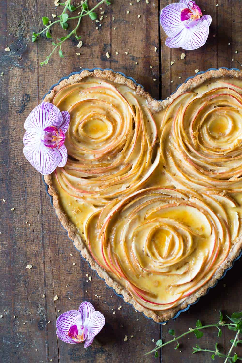 Valentine's apple rose tart decorated with orchids.