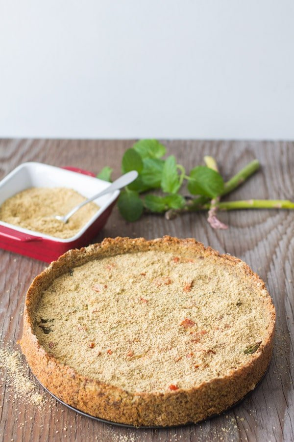 Flourless Vegan Vegetable Quiche on a wooden table.