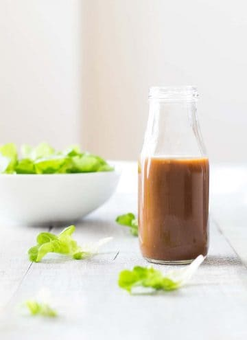 Open jar of Maple Mustard Balsamic Dressing.