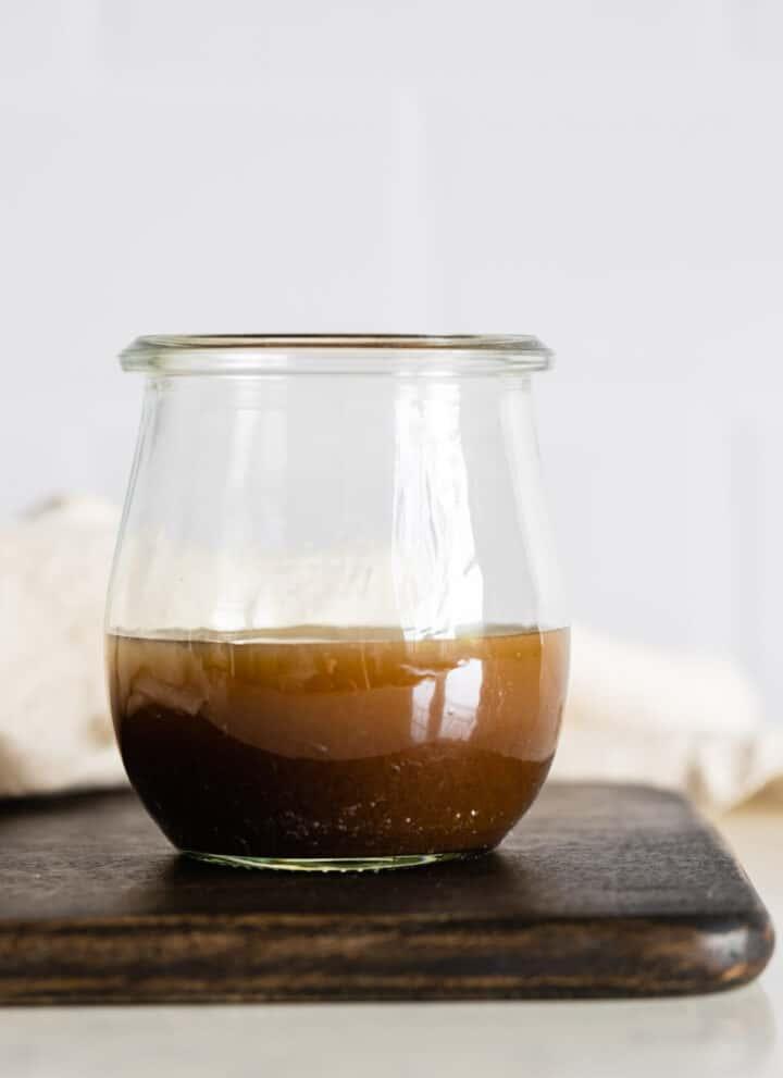 Maple Mustard Balsamic Dressing in a glass jar.