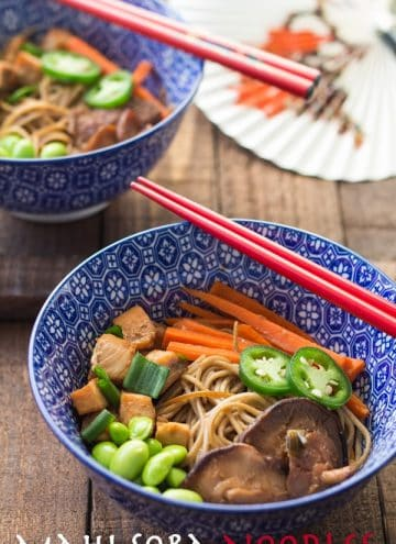 Mahi Soba Noodle Stir-Fry in a blue bowl with red chopsticks and text overlay.