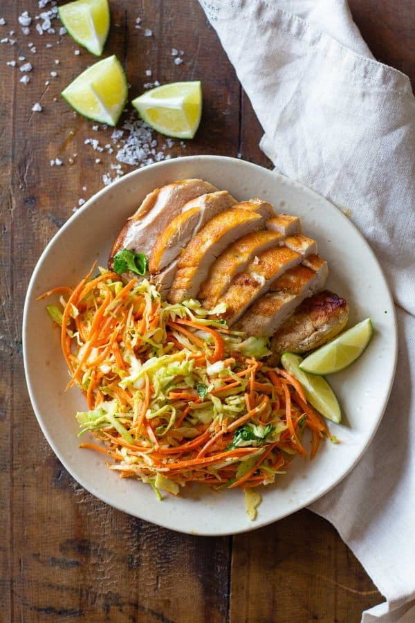 Cabbage Carrot Salad and sliced grilled chicken on a plate