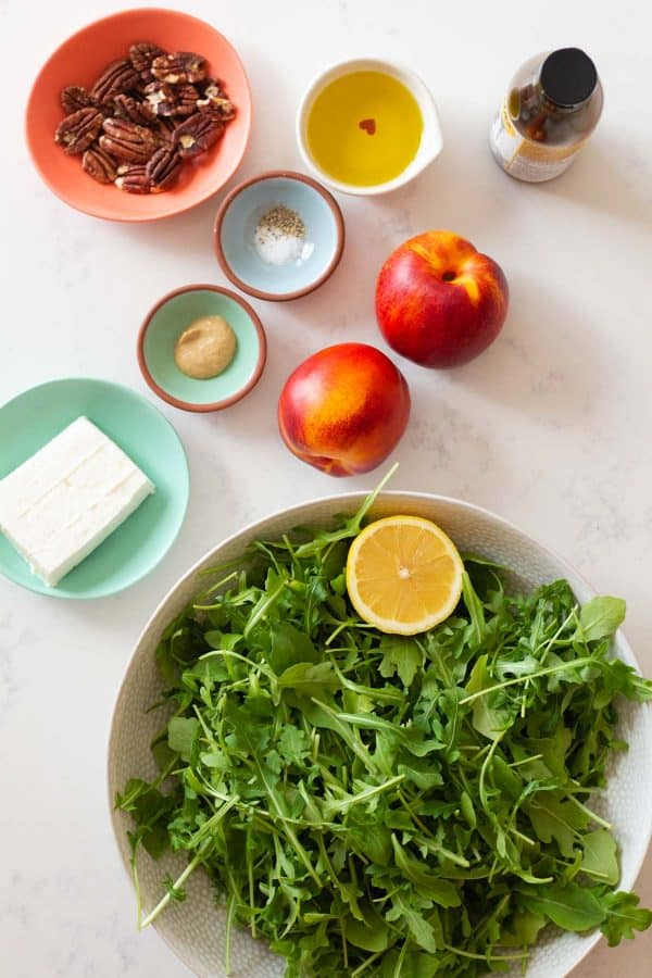 all ingredients for the Nectarine Arugula Salad as one flat lay