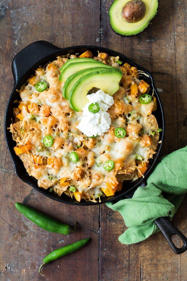 A healthier version of the cheesy nachos we all love digging into when watching TV. These Butternut Squash Nachos are full of healthy butternut, delicious goat cheese, melty manchego cheese and flavorful spicy chilies!