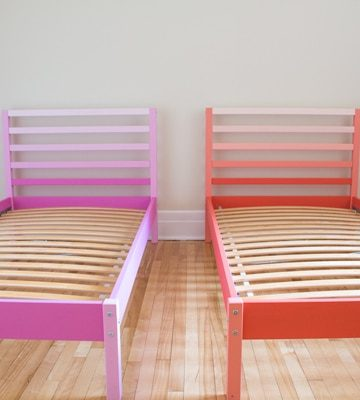 Pink and orange Ikea Tarva Beds side by side in a bedroom.