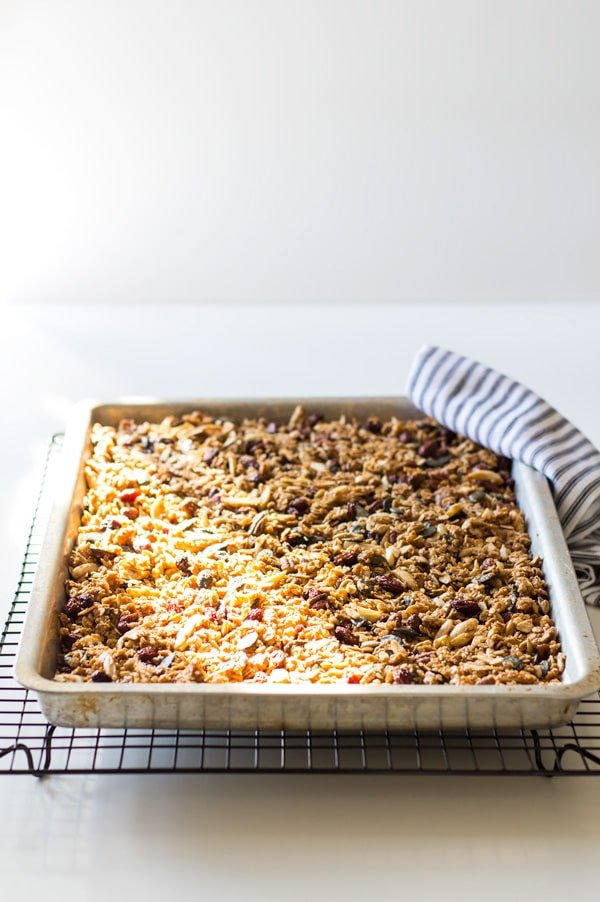 Healthy Homemade Granola in a baking pan cooling on a rack.