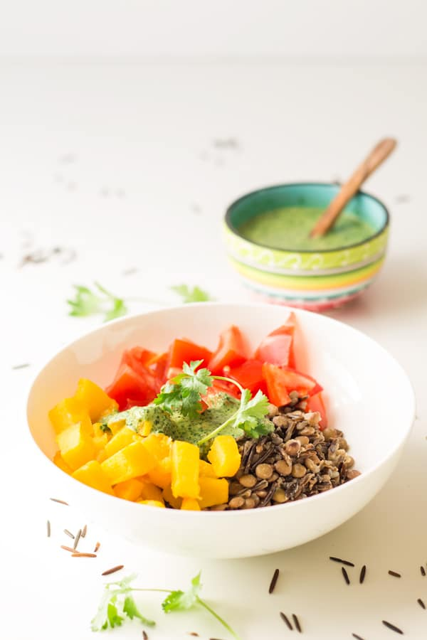 Healthy Warm Vegan Wild Rice Salad recipe with Out of This World Tahini Herb Sauce for real food dieters wanting a bowl of deliciousness for cold fall days.