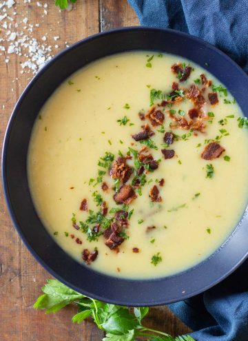 Potato Leek Soup in blue bowl with crispy bacon