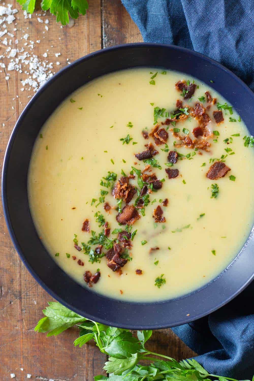 Potato Leek Soup in blue bowl with crispy bacon