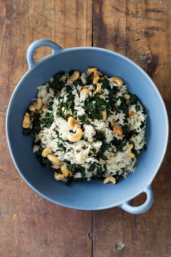 Leftover Rice with cashews and kale in a blue bowl