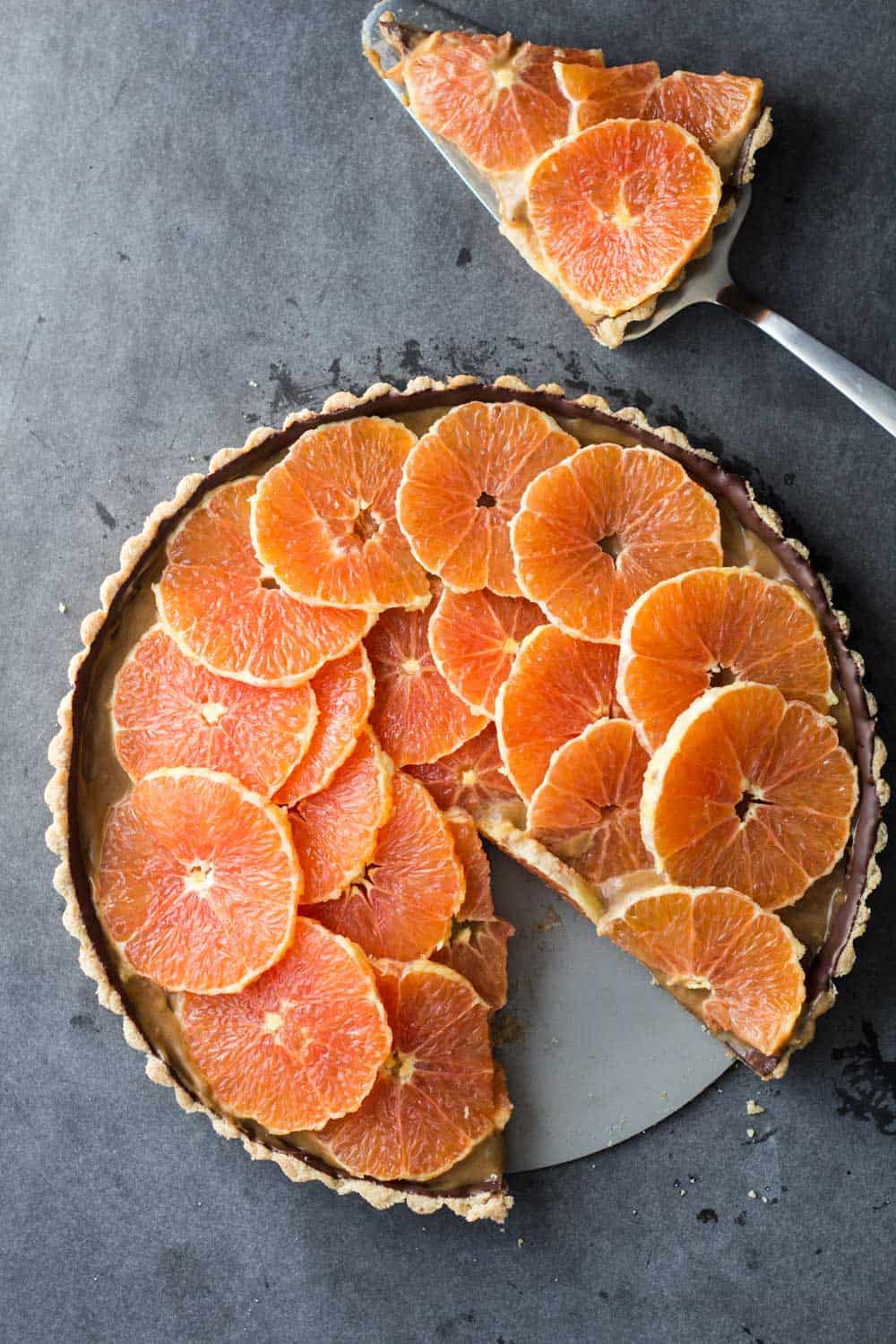 Piece cut out of chocolate orange tart