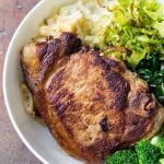 Close up of Perfect Pork Chop with mashed potatoes, celery, chard and broccoli.