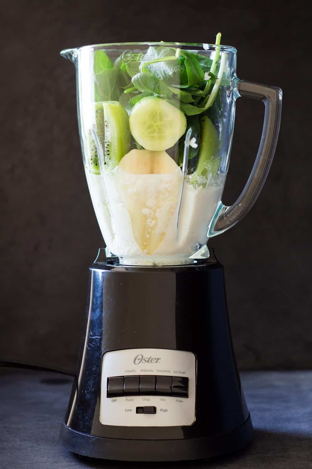 Ingredients for healthy green smoothie in blender
