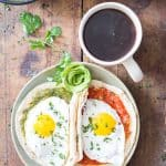 Huevos Divorciados - tortilla with salsa verde with egg and tortilla with salsa roja with egg
