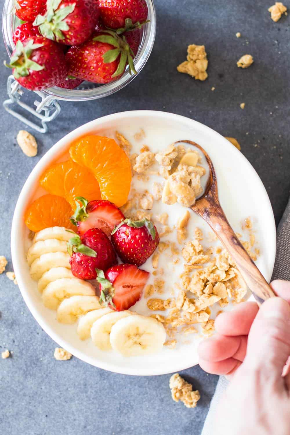 Peanut Butter Granola with fruit and milk