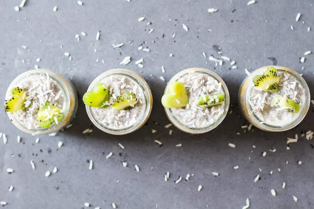 Top view of four jars of Tropical Chia Pudding.
