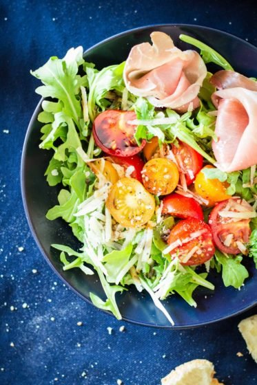 A quick and easy, fresh and crunchy Arugula Tomato Prosciutto Salad. Perfect summer lunch or summer dinner with easy balsamic dressing.