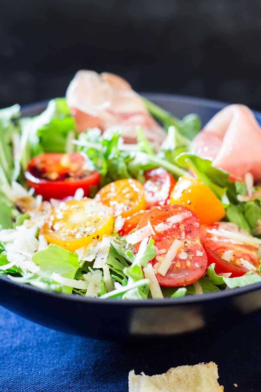 Close up of Arugula Tomato Prosciutto Salad to show texture.