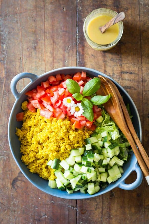 Healthy side dish for any BBQ: Turmeric Quinoa Salad. Fragrant turmeric quinoa, fresh cucumber, romaine lettuce & tomato & delicious honey mustard dressing.