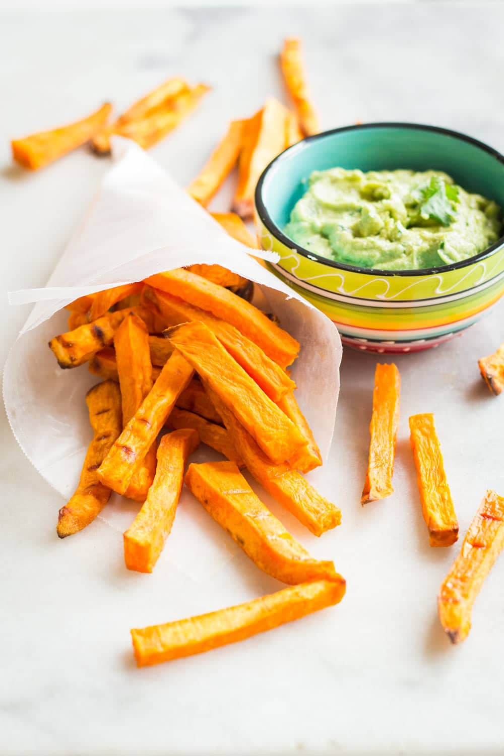 Beyond delicious Avocado Tahini Dip to dip your sweet potato fries in and indulge in a healthy snack. Great party appetizer, too!