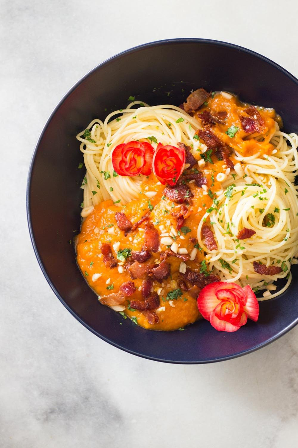 Bowl of spaghetti with Butternut Squash Pasta Sauce with Bacon.
