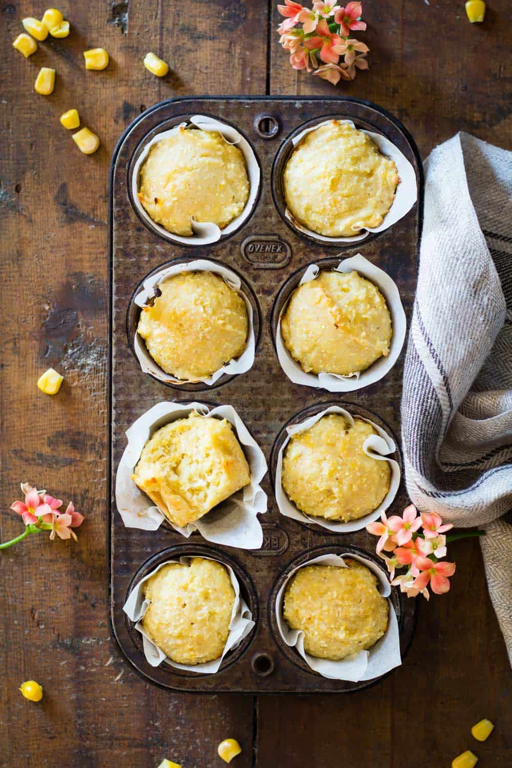 cornbread muffins in parchment paper in a muffin tin