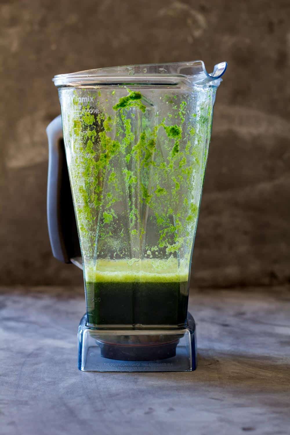 Blender with fresh coriander blended with water. How To Make Peruvian Green Rice Recipe