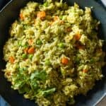 Green rice in a bowl.