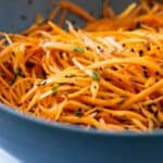 Carrot salad in a blue salad bowl.