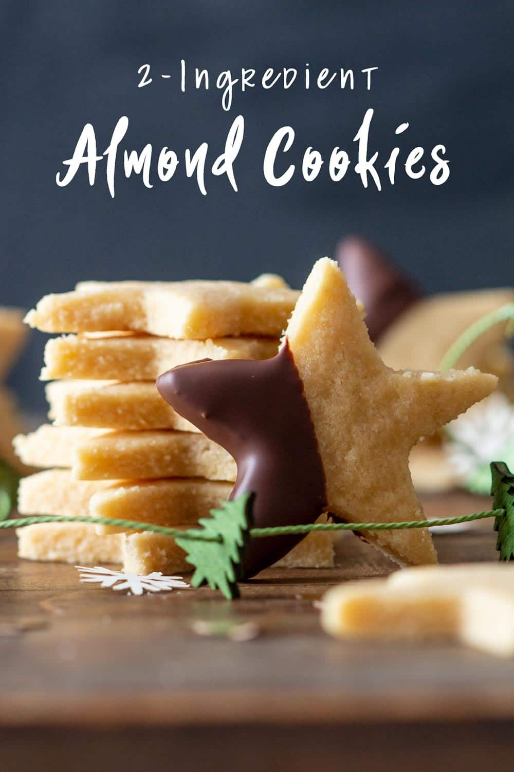 One Almond Flour Cookie leaning agains a stack of Almond Cookies