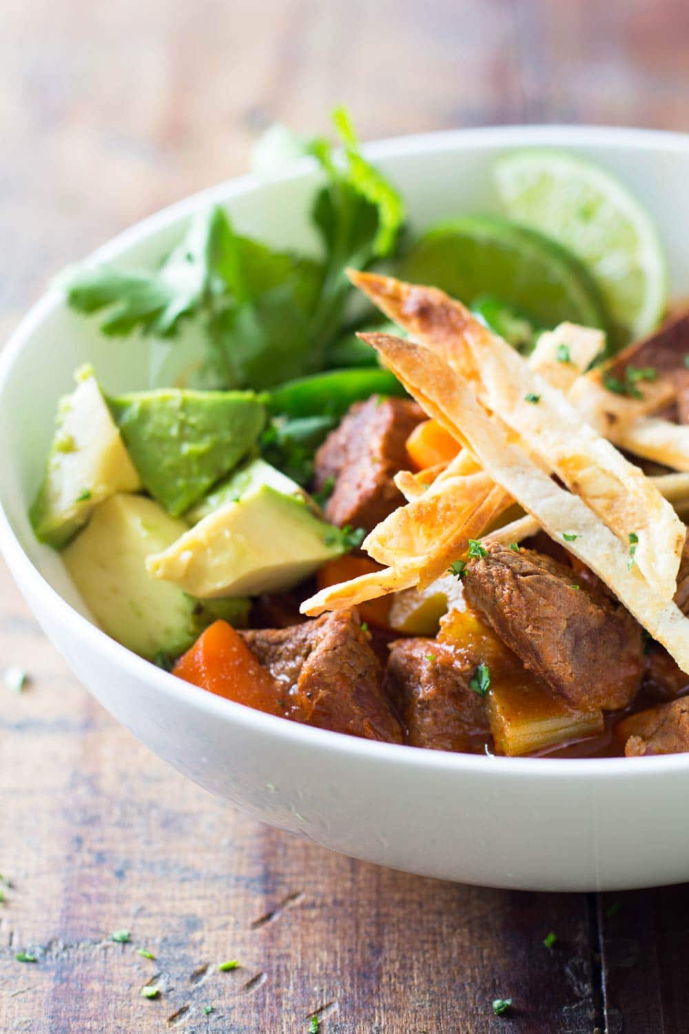 Mexican beef stew with avocado, jalapeño, tortilla chikps and lime.