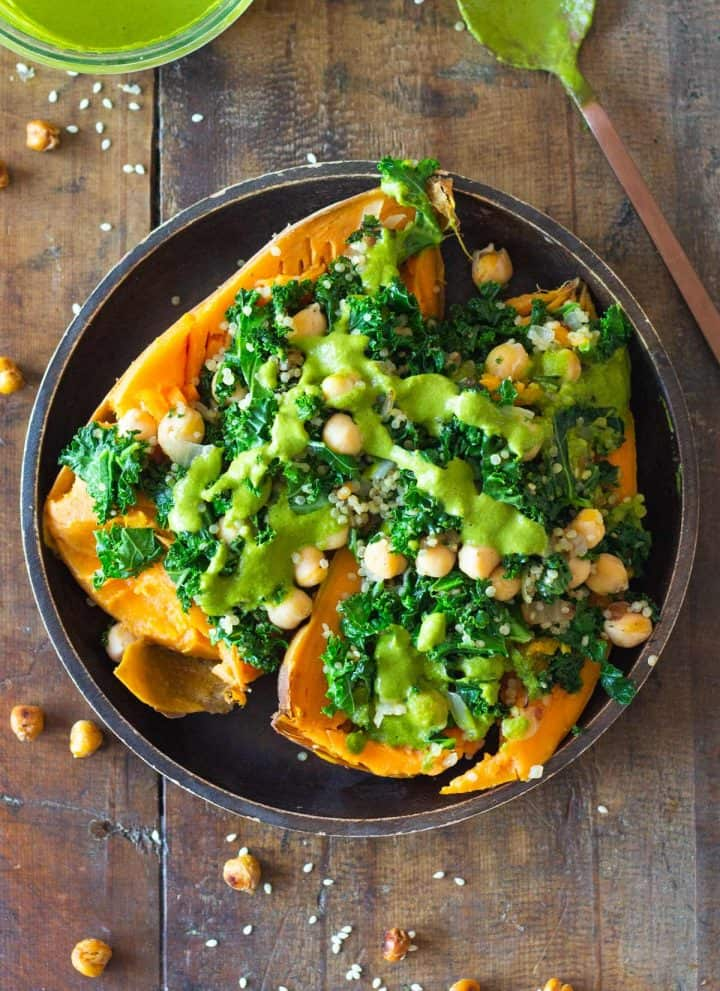 Kale Chickpea Quinoa Stuffed Sweet Potato with green sauce