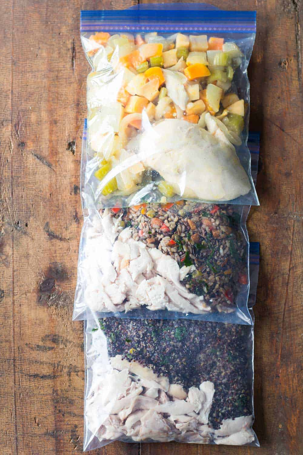3 Easy Healthy Freezer Meals in Ziploc bag one next to the other.