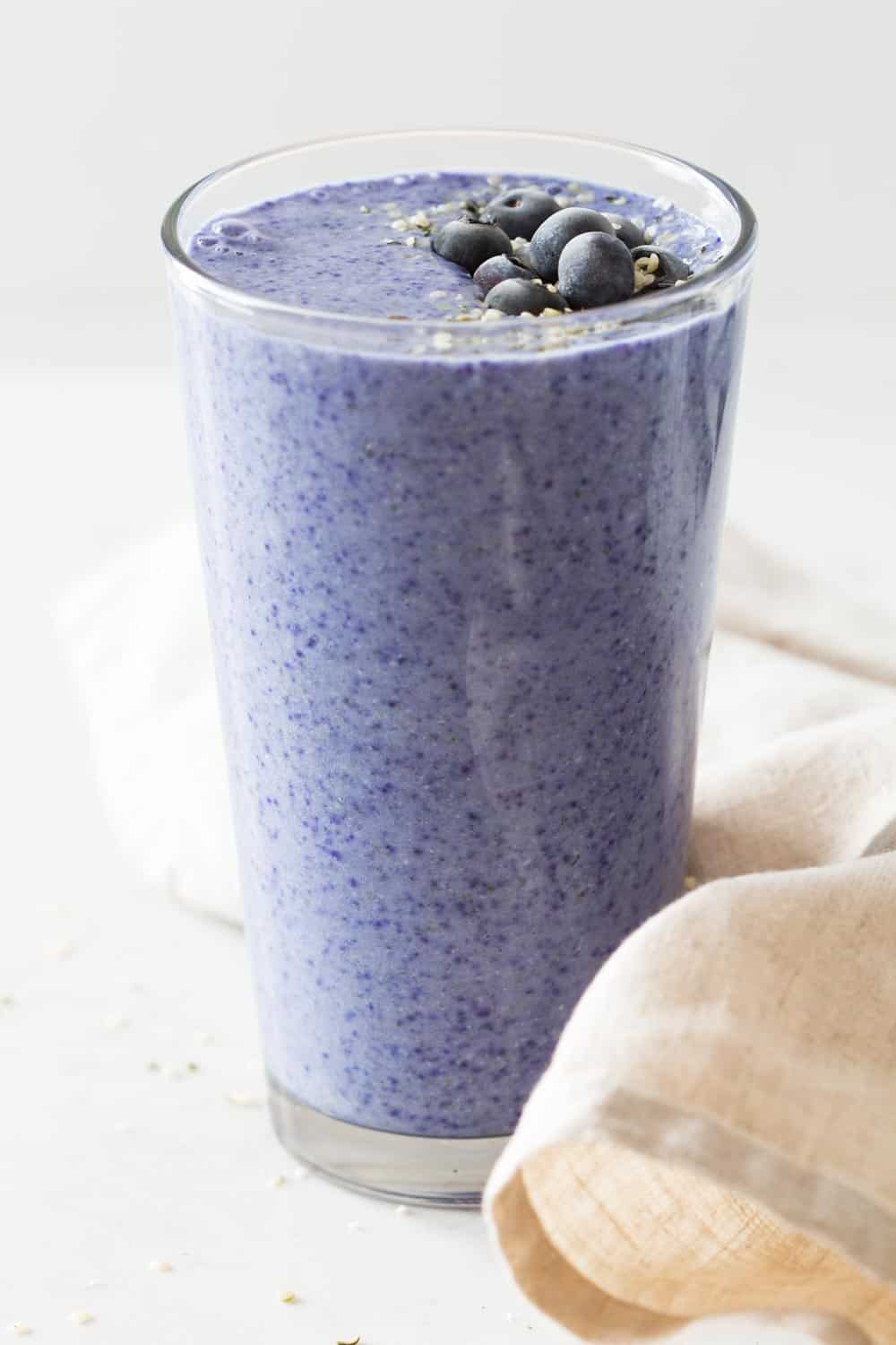 Butterfly Pea Tea Poweder Smoothie made frozen bananas, almond milk, hemp seeds. Almost purple smoothie.