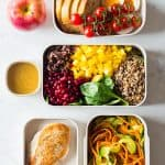 Several meal prep containers showcasing the food for the full clean eating meal plan
