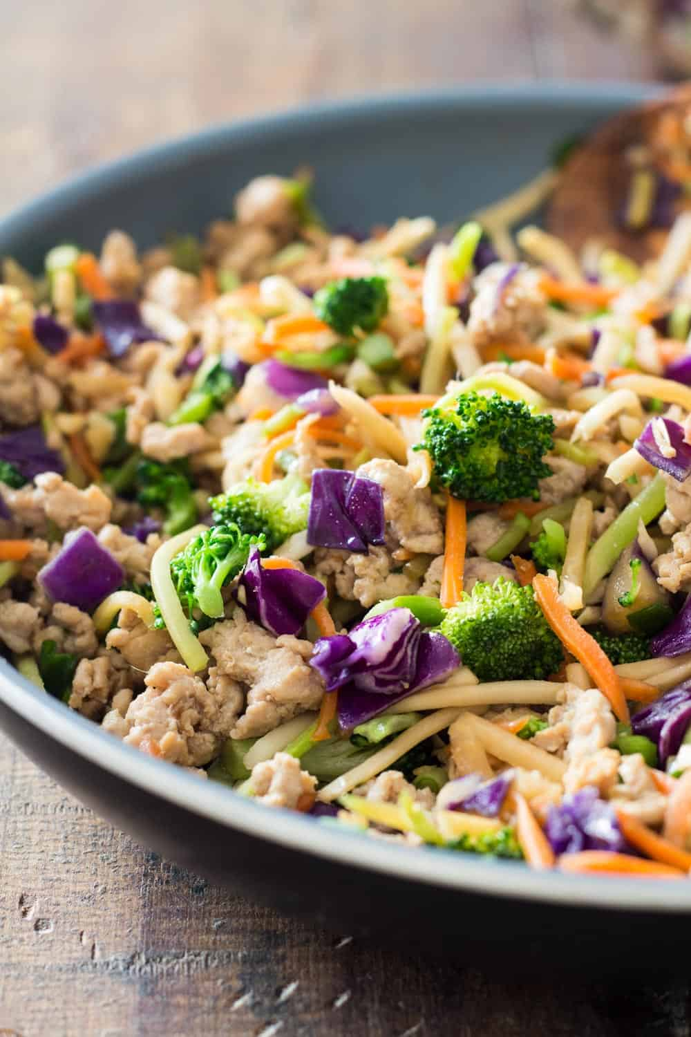 Close up of Low-Carb Stir-Fry showing cooked ground chicken and Mann's Rainbow Salad Veggie Mix.