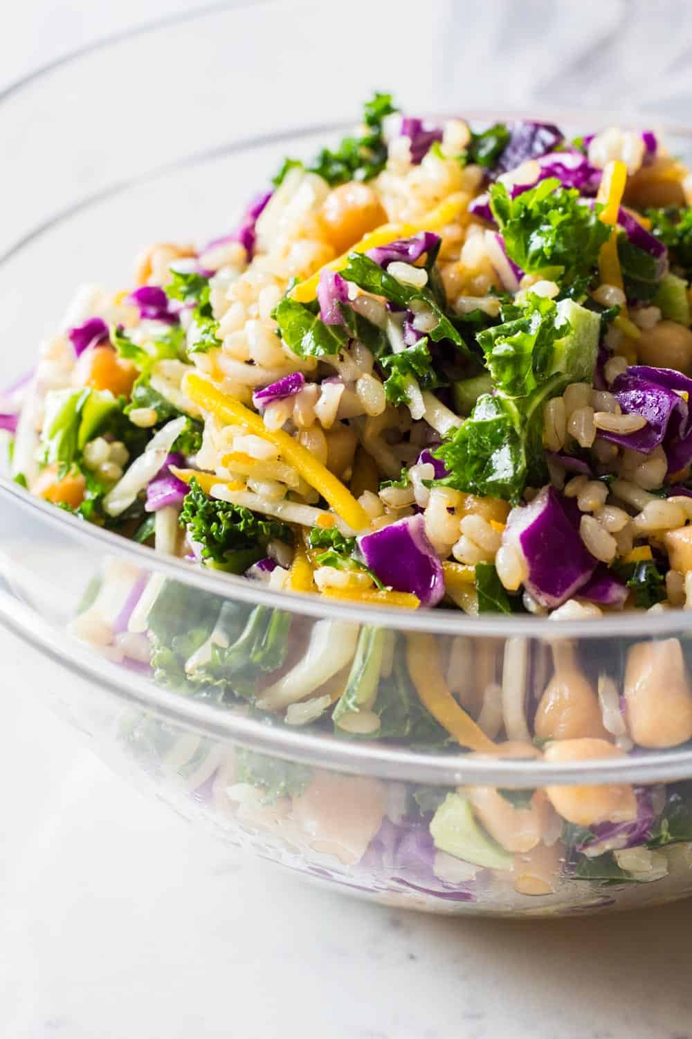 Close-up image of brown rice salad with julienned beets and kale