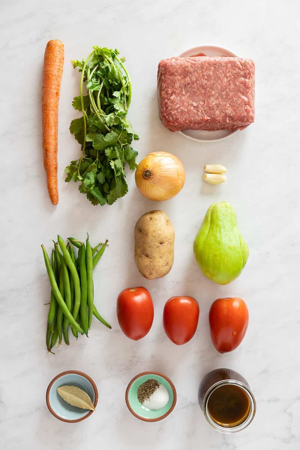 All ingredients required to make Mexican Picadillo on a kitchen counter.