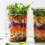 Healthy Chicken Pasta Salad layered in a glass jar.