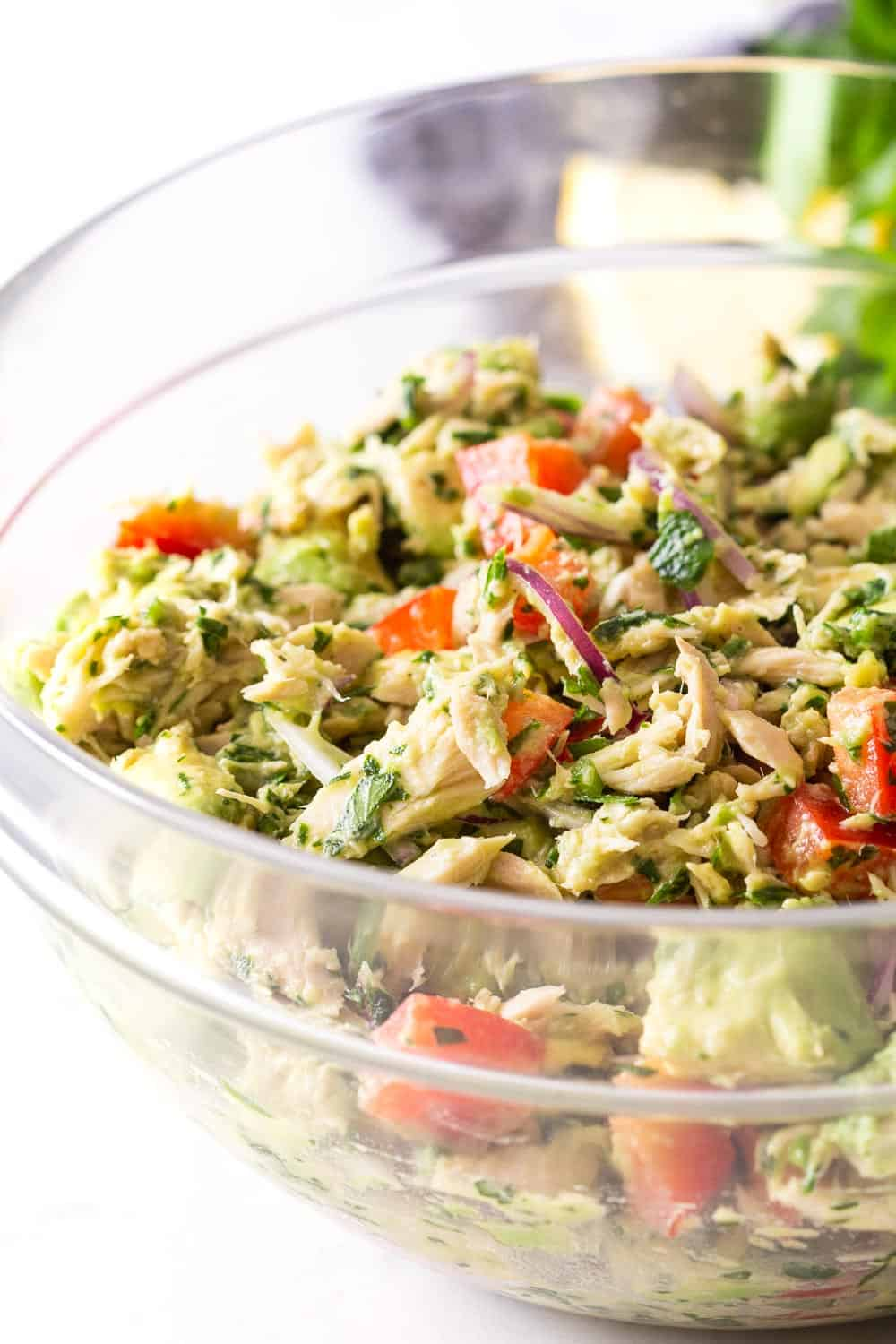 Tuna Avocado Salad all ingredients mixed up in a glass bowl.