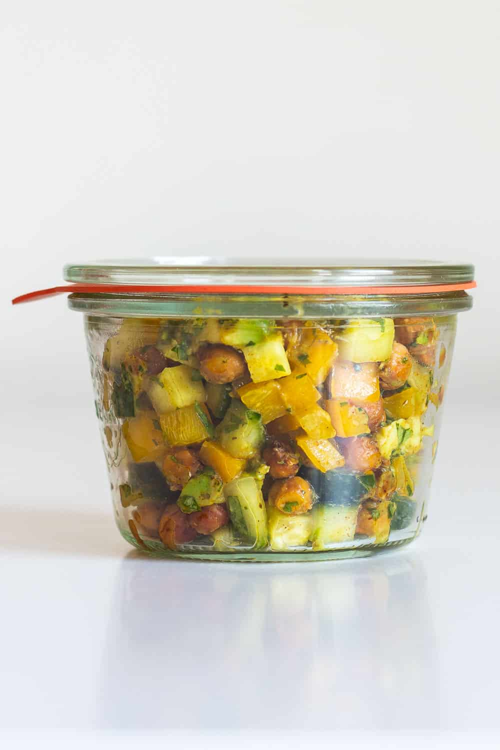 Cucumber Avocado Salad in a clear meal prep container