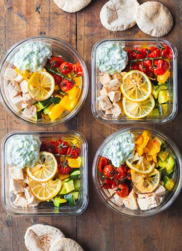 4 Greek Chicken Meal Prep Bowls with Tzatziki and pita bread