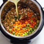 Ingredients for Instant Pot Lentil Soup shown in Pressure Cooker.