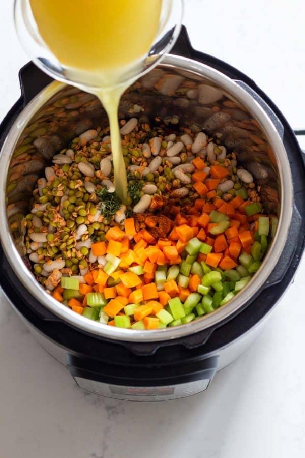 Ingredients for Instant Pot Lentil Soup shown in Pressure Cooker. How To Make the Best Instant Pot Lentil Soup