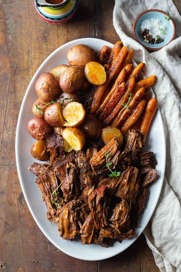 Pot Roast with Potatoes and Carrots made in the Instant Pot served on a white serving plate