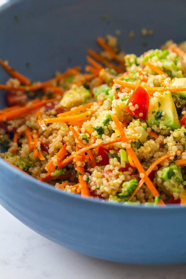 Mixed quinoa salad in a blue bowl.